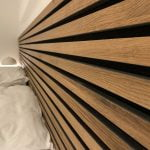 Close-up of a headboard with acoustic rustic Oak Akupanels